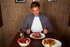 Eat a beef steak Royalty Free Stock Images