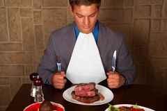Eat a beef steak Royalty Free Stock Image