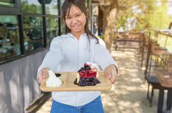 Eat blueberry cheesecake. Asia teenage girl filed the blueberry cheesecake comes in front Royalty Free Stock Photos