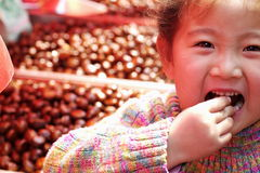 Eat chestnuts Stock Photo