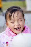 Eat the Chinese female of cotton candy. Chinese woman eating cotton candy in the park Royalty Free Stock Photos