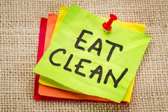 Eat clean reminder on sticky note Stock Images