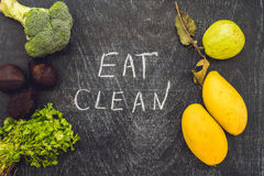 Eat clean is written on chalk board. clean food concept Royalty Free Stock Photography