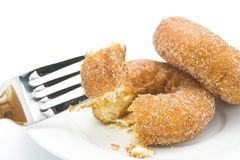 Eat a donut. Eat donut with a fork, close-up shooting Royalty Free Stock Photos