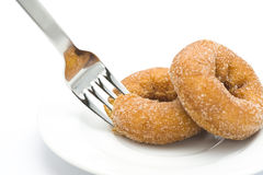 Eat a donut. Eat donut with a fork, close-up shooting Royalty Free Stock Images