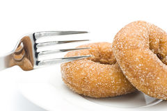 Eat a donut. Eat donut with a fork, close-up shooting Stock Image