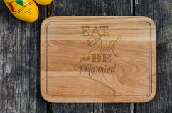 Eat Drink and Be Married wood cutting board Stock Images