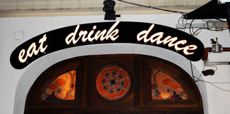 Eat, drink, dance - neon, Bucharest, Romania Stock Photo
