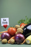 Eat Fresh message sign with fresh raw vegetarian food - vertical. Stock Images