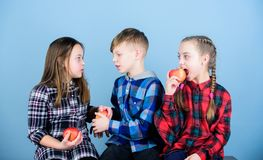 Eat fruit and be healthy. Promoting healthy nutrition. Boy and girls friends eat apple. Teens with healthy snack. Group. Teenagers cheerful kids hold apples royalty free stock photos