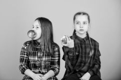 Eat fruit to be cute. Small girls eating apples together. Little girls enjoy fresh fruits. Cute girls eating healthy royalty free stock image
