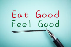 Eat good Feel good. Text Eat good Feel good with underline and a ball pen aside royalty free stock image