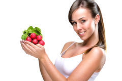 Eat healthily - Beautiful woman holding a bunch of radishes Stock Photos