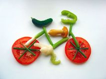 Eat healthy!. A colorful toy bike made of sliced vegetables Stock Images