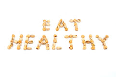 Eat Healthy. Nuts are shaped of words of (EAT HEALTHY) as a symole of good nutrition stock photos