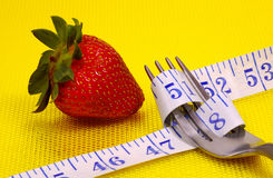 Eat Healthy 2. Fork with Tape Measure and a Strawberry. Diet Concept Royalty Free Stock Images