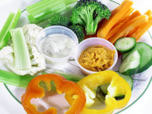 Eat Healthy. Vegetable plate.  Somewhat shallow depth of field.  Majority of the focus on the center where the dips are Royalty Free Stock Photos