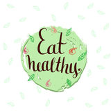 Eat healthy - hand lettering phrase. Stock Photography