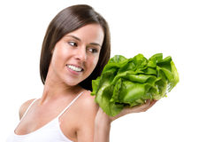 Eat healthy! Pretty woman holding a salad Stock Image