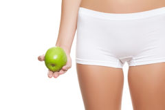Eat healty and have perfect skin. Woman holding an apple without signs of cellulitis Stock Images
