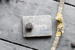 Eat heathy. Fruit diet, dieting, nutrition, vegetarian concept. Eat heathy inscription and blackberries on a wooden table Royalty Free Stock Images