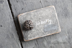 Eat heathy text. Eat heathy inscription and blackberries on a wooden table Stock Image
