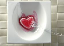 Eat a jelly strawberry bloody heart. Romantic metaphor royalty free stock image