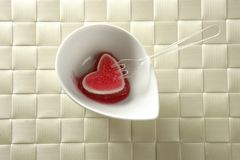 Eat a jelly strawberry bloody heart Stock Image