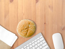 Eat junk and work. Stock Image