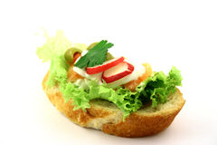 Eat me!. Fresh sandwich with salmon and egg on the iceberg lettuce Stock Image