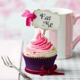 Eat me cupcake. Cupcake with Eat Me pick royalty free stock image