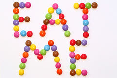 EAT ME Smarties. Colorful Chocolate Smarties precisely laid out to spell EAT ME Royalty Free Stock Images