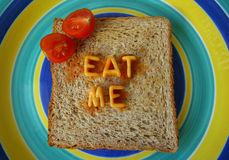 Eat me words on toast royalty free stock photo