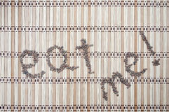 Eat me words written with lentils. Pattern Royalty Free Stock Image