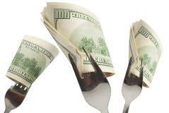 Eat the money. Stock Photo
