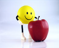 Eat More Fruits. Smiley face guy with apple Stock Images