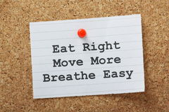 Eat Right, Move More, Breathe Easy. The phrase Eat Right,Move More and Breathe Easy on a note pinned to a cork notice board as a motivational call to exercise Stock Photos
