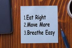 Eat Right, Move More, Breathe Easy. Written on note. Diet and Fitness Advice royalty free stock photo