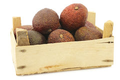 Eat ripe avocado`s in a wooden crate stock photos