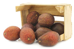 Eat ripe avocado`s in a wooden crate royalty free stock photography