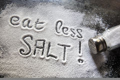Eat Less Salt. Message about excessive salt consumption Stock Images