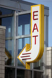 Eat Sign. A sign saying EAT with an arrow at a restaurant stock photography