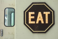 Eat. An Eat sign on a food truck in New York City stock photos