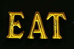 Eat sign neon lights Royalty Free Stock Photos