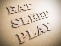 Eat Sleep Play, Motivational Words Quotes Concept. Eat Sleep Play, business motivational inspirational quotes, wooden words typography lettering concept royalty free stock images