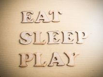 Eat Sleep Play, Motivational Words Quotes Concept. Eat Sleep Play, business motivational inspirational quotes, wooden words typography lettering concept royalty free stock photography