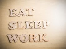 Eat Sleep Work, Motivational Words Quotes Concept. Eat Sleep Work, business motivational inspirational quotes, wooden words typography lettering concept royalty free stock image