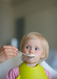 Eat smeared baby feeding by mother Royalty Free Stock Image