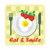 Eat & Smile - tomato and fried egg Stock Image