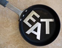 EAT spelled out in frying pan Royalty Free Stock Photography